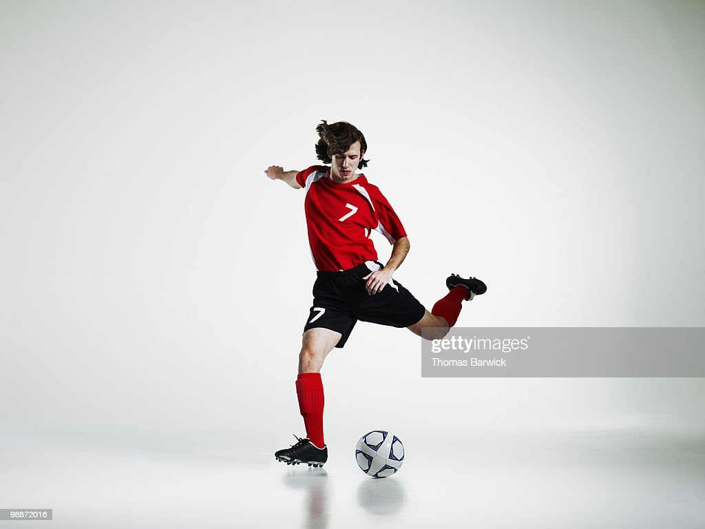 Male soccer player preparing to kick soccer ball