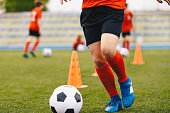 Male soccer player - slalom drills training. Football practice session