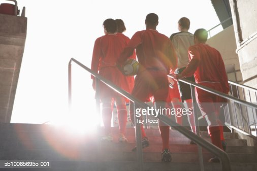 Male soccer team entering stadium