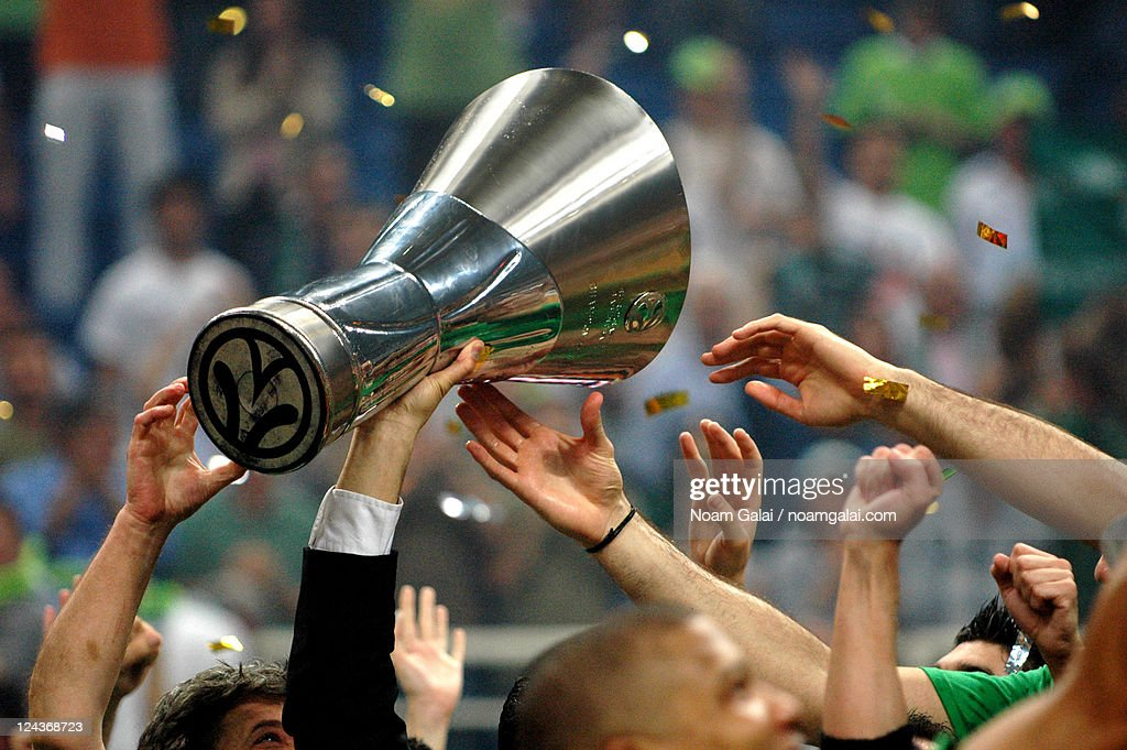 Male sports team holding up trophy : Stock Photo