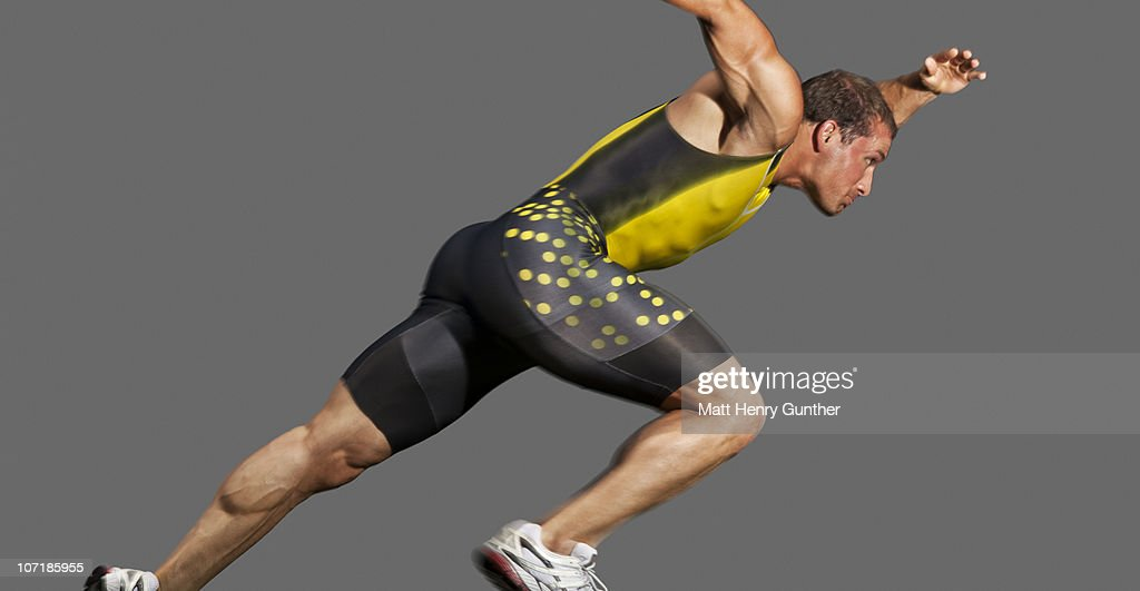 Male sprinter taking off from starting blocks