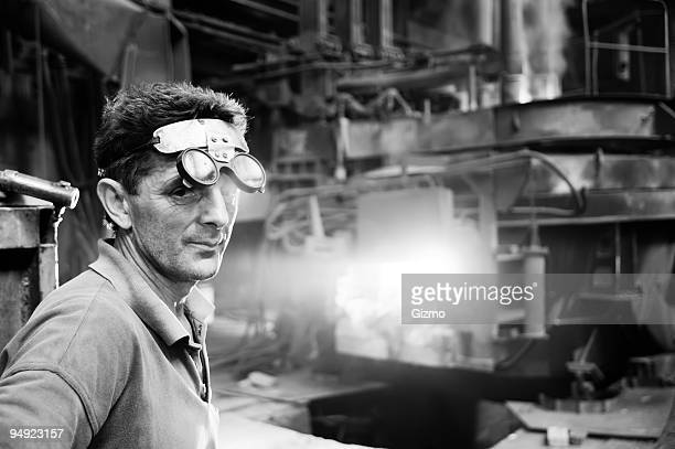 Male steel mill worker with specialist glasses