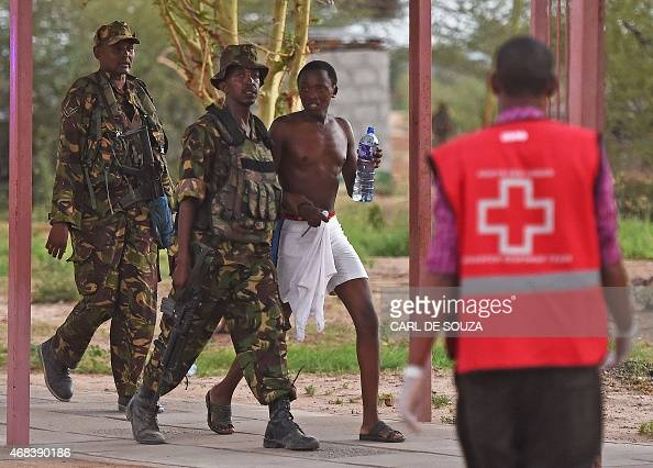 A male student hostage is escorted out of Garissa University after Kenya Defence Forces ended a siege by terrorist gunmen on April 2 2015 At least 70...