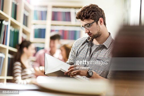 Male student in library.