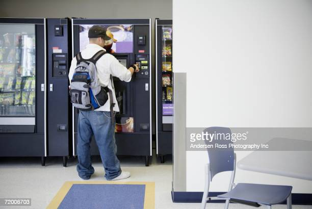 Male student using vending machine