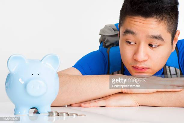 Male student with piggy bank