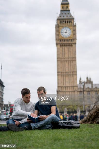 Male students studying outdoors in London