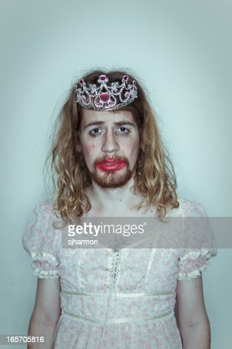 Male Sulking Prom queen in drag tiara on head lipstick