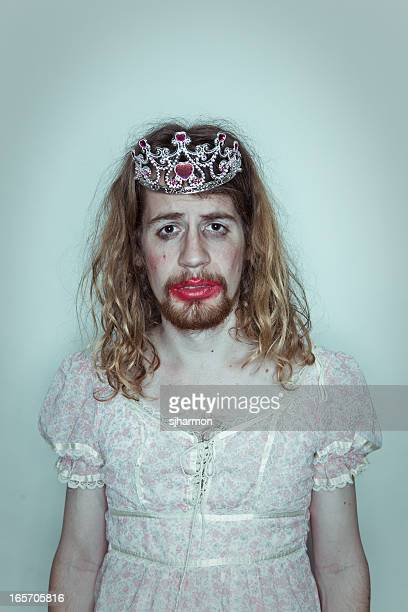 Male Sulking Prom queen in drag tiara on head lipstick