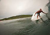 A male surfer in a barrel of a wave in Nicaragua