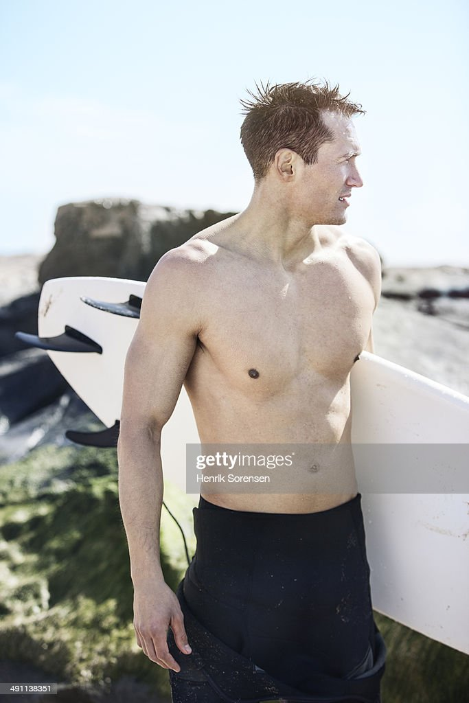 Male surfer on the beach : Stock Photo