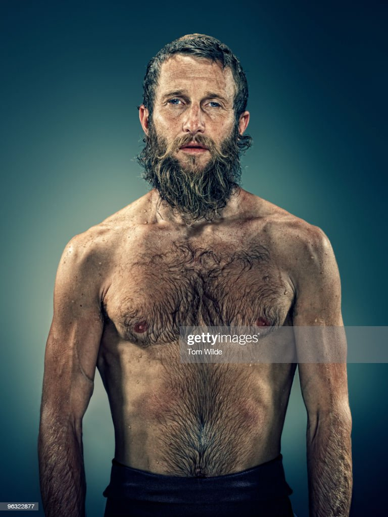 Male surfer with wet beard and hair : Stock Photo