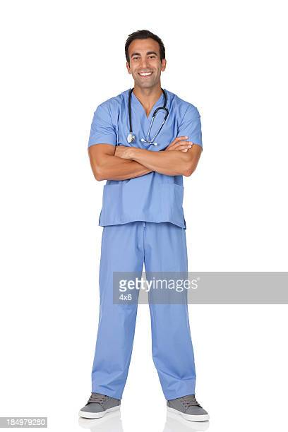 Male surgeon standing with his arms crossed