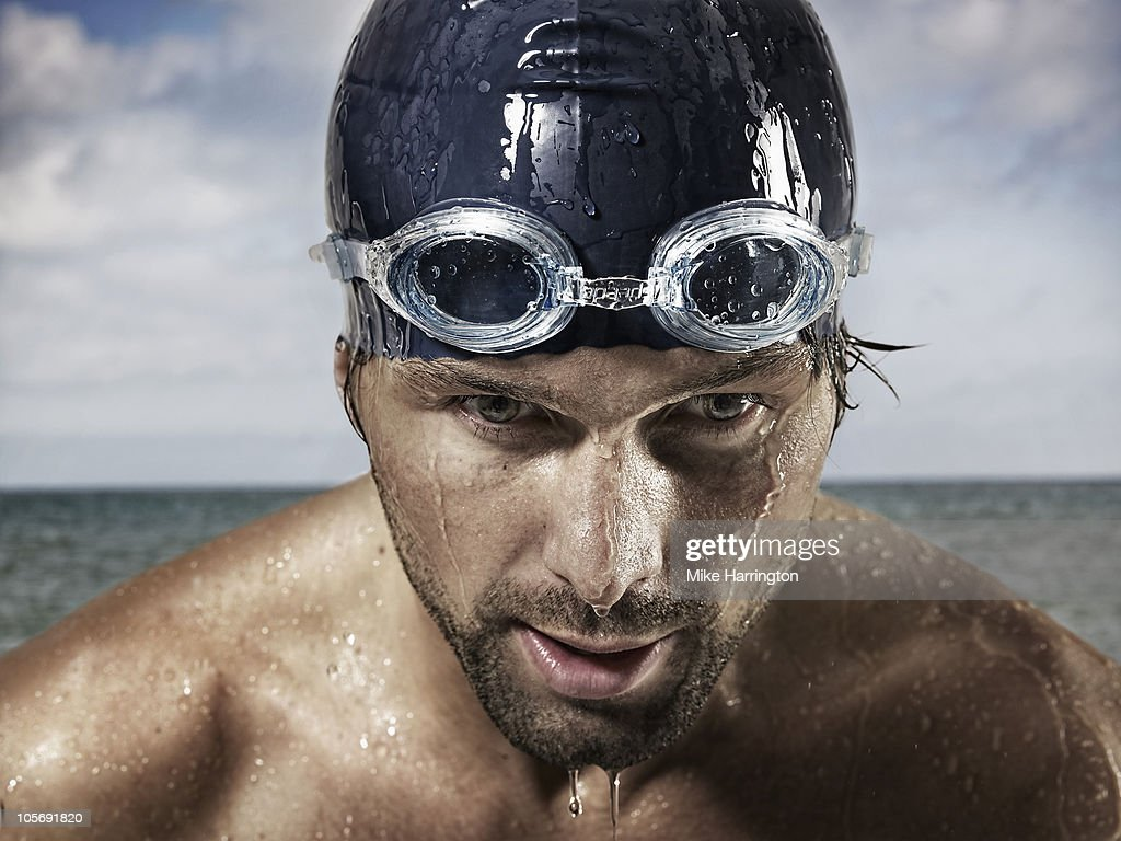 Male Swimmer Standing By Coast : Foto stock