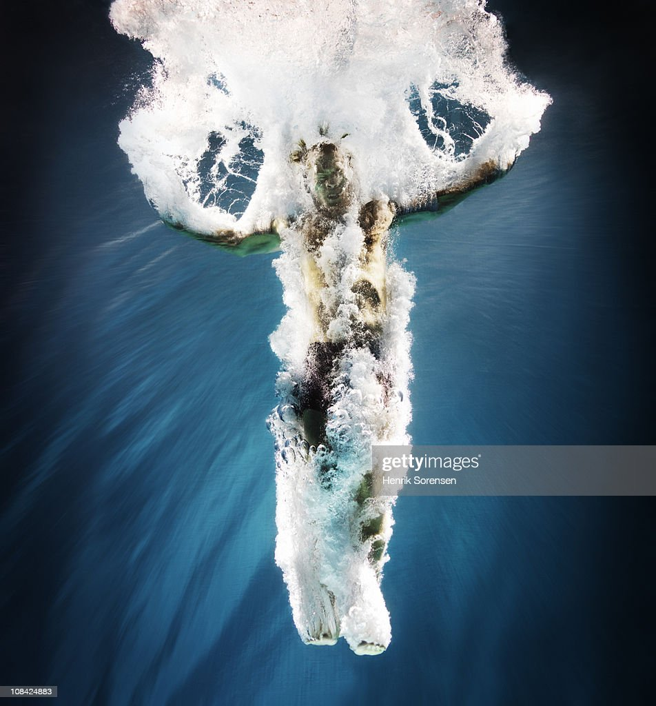 Male swimmer under water with bubbles : Stock Photo