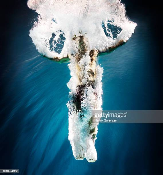 Male swimmer under water with bubbles