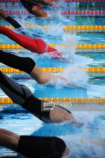 Male swimmers diving