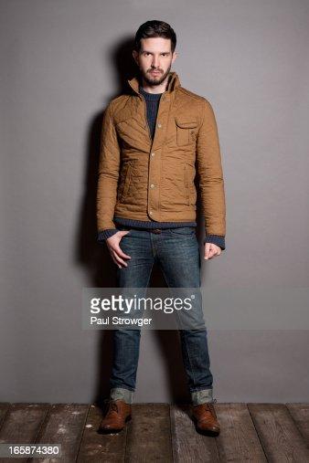 Male, Tan Coat, Grey Background