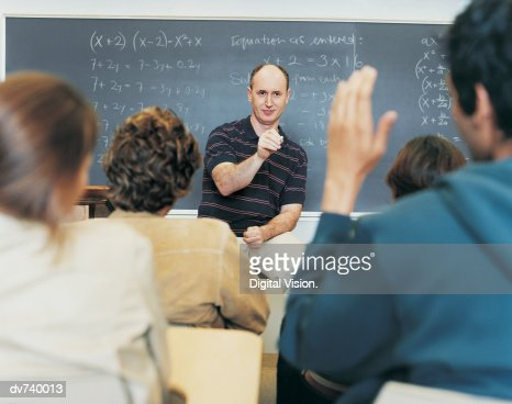 Male Teacher Asking Students Questions During Seminar : Stock Photo