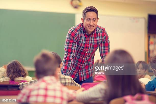 Male teacher in the classroom.