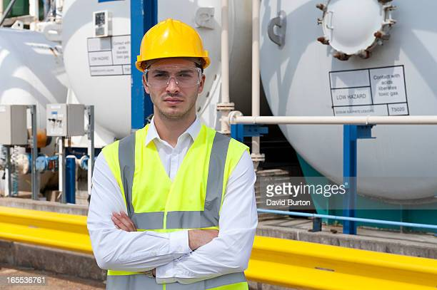 male technician working in industrial chemical plant