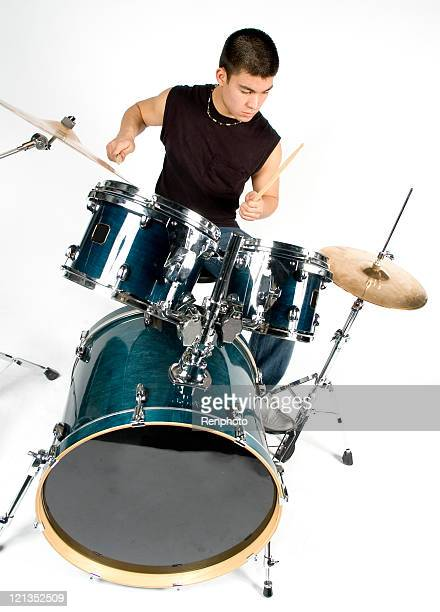 Male Teenager Playing Drum Set Isolated one White Background