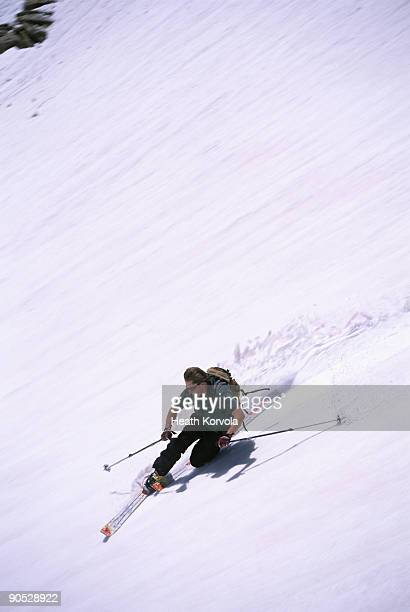 Male telemark skier ripping the spring slopes of Beartooth Pass on Montana on the Wyoming border nea