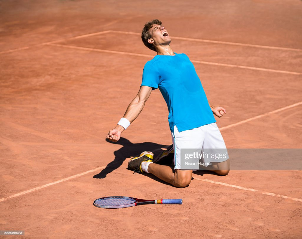 Male tennis player celebrating win : Photo