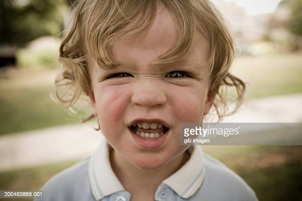 Male toddler (21-24 months) making face, close-up