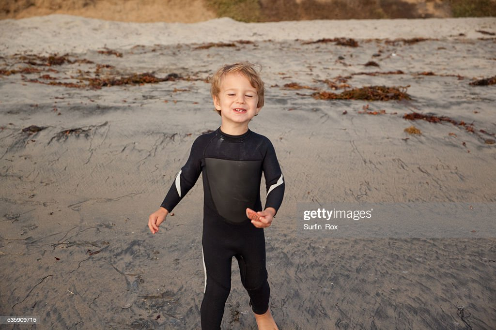 Male Toddler Playing On Southern California Beach In Wetsuit : Stock Photo
