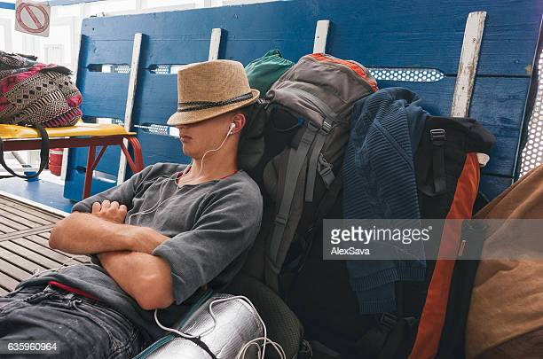 Male tourist  relaxing on the deck of a sailing boat
