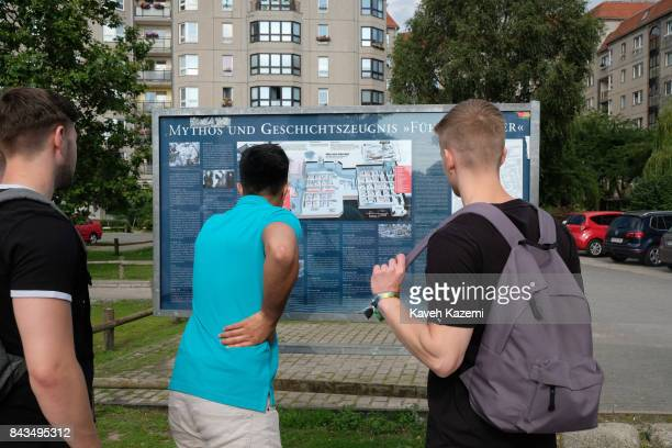 Male tourist youth look at the information board posted outside Hitler's bunker near the Reich Chancellery in Berlin on July 14 2017 in Berlin...