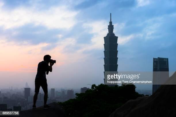Male traveler shooting Taipei 101, Taipei, Taiwan
