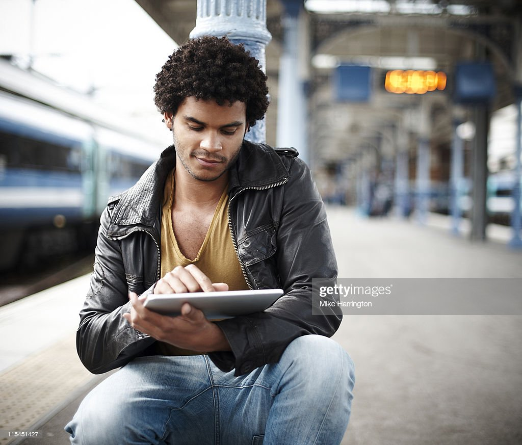 Male Using Digital Tablet At Train Station : Stock Photo