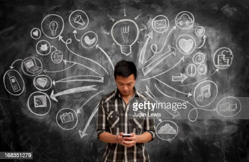 Male using phone by chalkboard w/social media icon