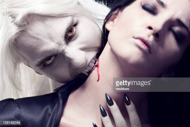 Male Vampire is biting a beautiful woman.