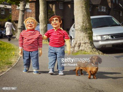 2 male Ventriloquist dolls walk their dog