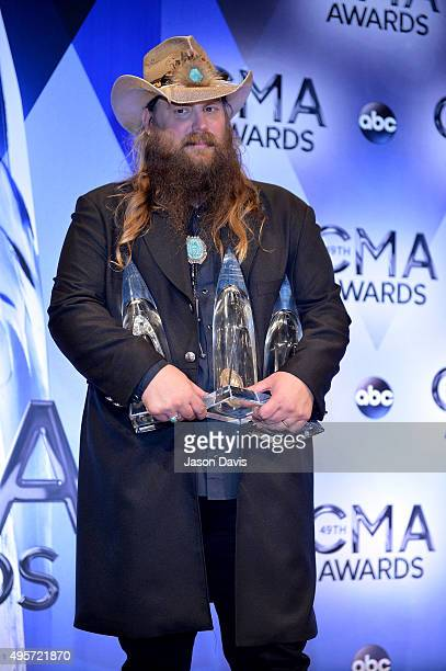Male Vocalist of the Year winner Chris Stapleton poses in the press room during the 49th annual CMA Awards at the Bridgestone Arena on November 4...