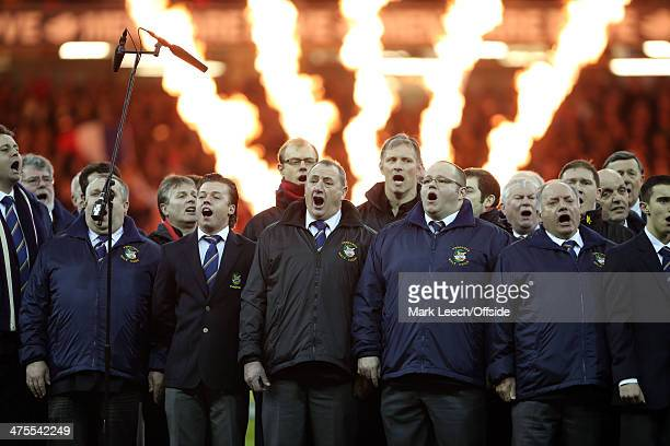 A male voice choir sings as flames burst prior to the RBS Six Nations match between Wales and France at the Millennium Stadium on February 21 2014 in...
