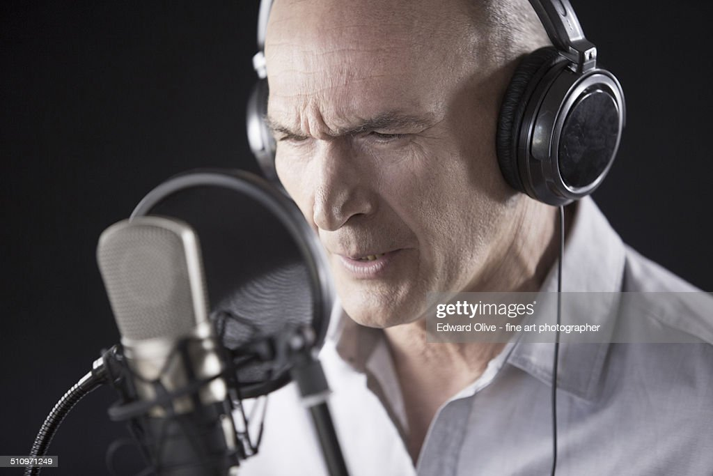 Male voiceover actor in recording studio