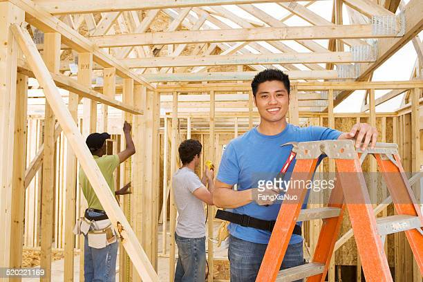 Male volunteer at home construction site, portrait