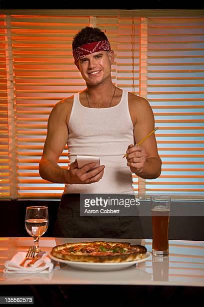 Male waiter taking food order