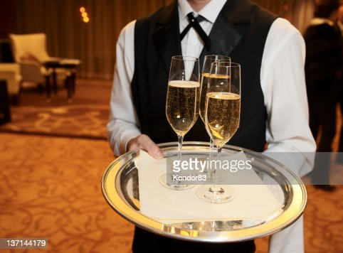 Male waiter with champagne flutes : Stock Photo