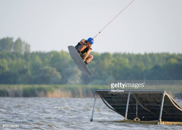 Male wakeboarder flying in midair