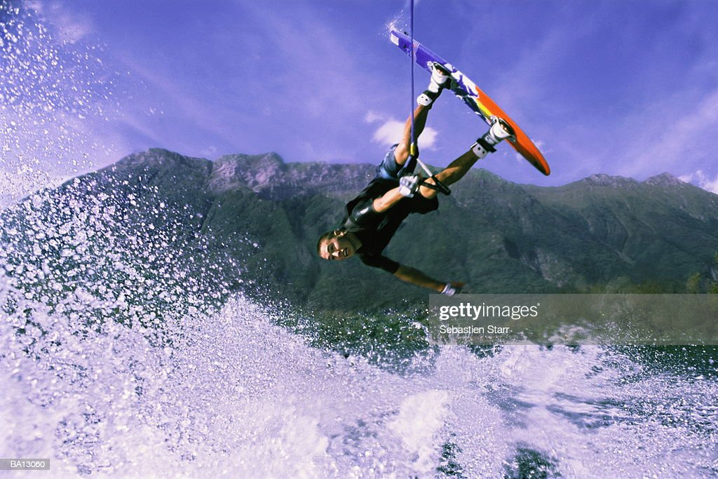 Male wakeboarder in mid air : Stock Photo