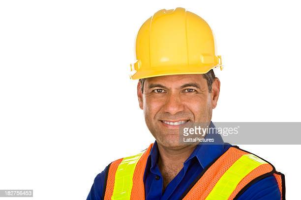 Male wearing hard hat and safety vest construction worker