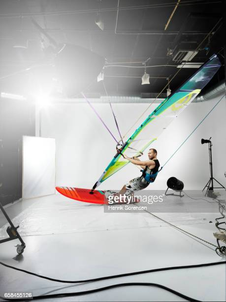 Male windsurfer in a studio