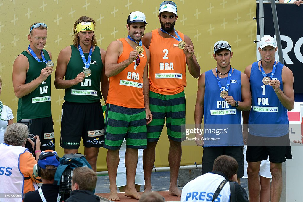 Male winner teams show their medals on the podium during the FIVB Grand Slam final match day at The Hague Beach Stadium on June 16, 2013 in The Hague, Netherlands.