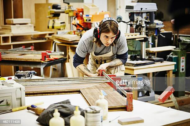 Male woodworker in shop joining custom shelving