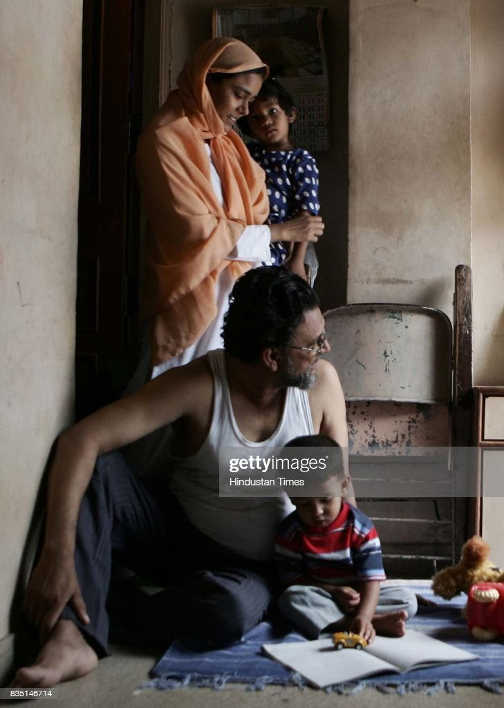 Iqbal Magdoomi the father of bomb blast accused Dr Faroogh Maqdoomi, playing with Farrogh's three year old son Hasan at their residence in Malegaon.